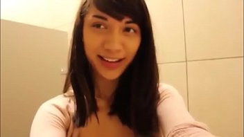 Asian teen Mei masturbates in public restroom