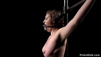 Masochist brunette suffers extreme bondage