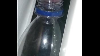 pissing in a bottle