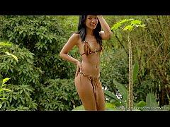 Carol Lopez takes off her bikini in the woods