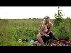 Teen backbacker doggystyled on countryside