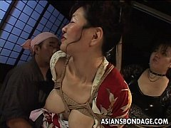 Bound Japanese MILF groans while her pussy is teased