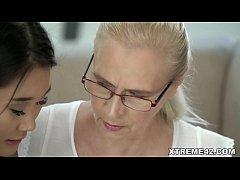 Asian teen tutoring an old woman