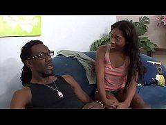 Hung black stud nails young ebony on the sofa
