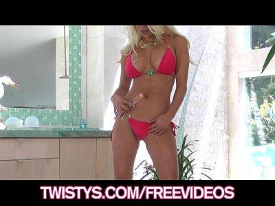 Busty blonde bikini babe plays with her new glass dildo
