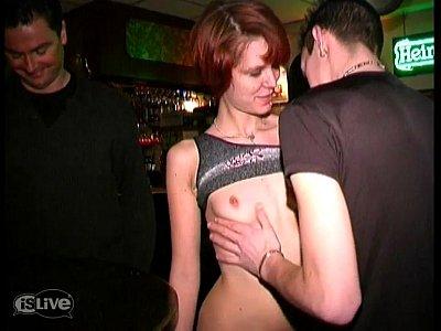 Redhead fucked in a bar