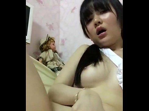 Asian teen girl fingering her hairy pussy on webcam
