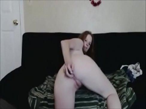 Redhead milf fucks herself anally