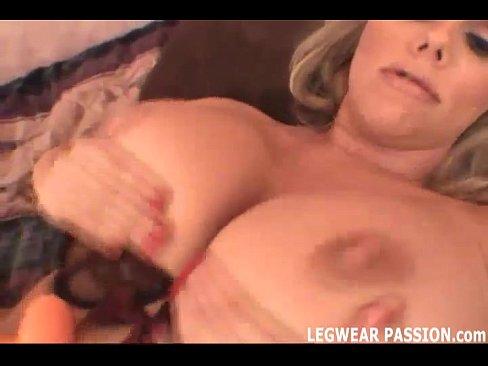 Busty hot blonde Karen teasing with an enormous nice dildo
