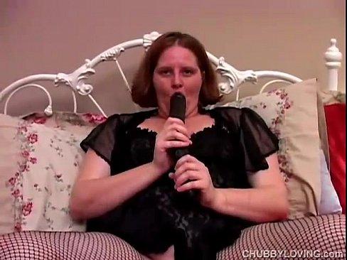 sassy fatty in fishnets fucks a huge dildo