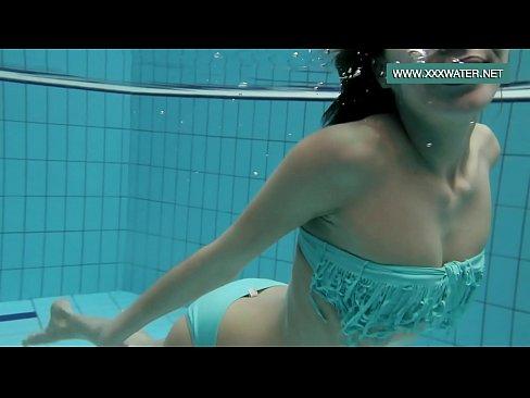 podvodkova swimming in blue bikini in the pool